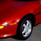 A red sports car after a dent & scratch removal program.